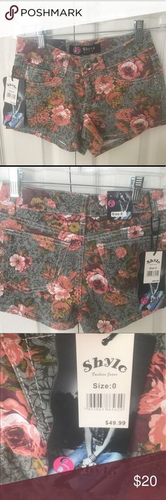 Flower shorts. BNWT size 0 Olive green background with coral and hints of purple and cream and dark yellow flowers rhinestone button to close them up with shylo Shorts
