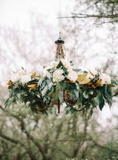 Chandelier with Greenery and Flowers | photography by http://www.marielhannahphoto.com/