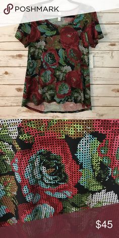 NWT LULAROE CLASSIC T NWT LULAROE CLASSIC T. UNICORN ROSES.  So pretty and classy. 96% Polyester 4% Spandex. LuLaRoe Tops Tees - Short Sleeve