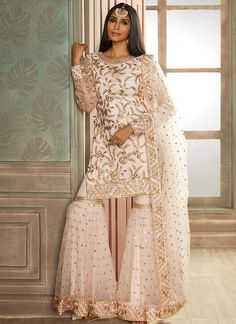 Pink and Gold Heavy Embroidered Gharara Suit features net kameez with santoon inner, net bottom with santoon inner and net dupatta. Embroidery work is completed with thread, zari and sequins embellishments. Pakistani Wedding Outfits, Pakistani Dresses, Indian Dresses, Indian Outfits, Indian Clothes, Punjabi Wedding, Desi Wedding, Sharara Designs, Indian Designer Outfits