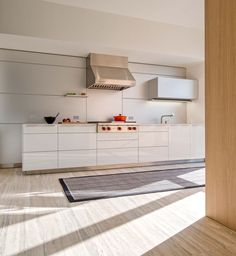 modern kitchen with bleached wood floors and bulthaup cabinets