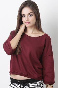 Chill out and look stylish in the Roxanne Sweat Top. This top features relax sleeves with ribbed details, a round neckline, semi crop fit, small side cuts, finished with soft stretch knit.