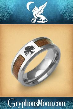 Wood Inlay Tree of Life Ring - The strength of steel, combined with the natural beauty of genuine wood grain inlay creates a powerful and eye-catching design. And, as its central motif, a timeless Tree of Life has been etched into the stainless steel, echoing the wood's living origin. #Tree #Forest #TreeHugger #NatureLover #TreeOfLife #TreeOfLifeRing #TreeRing #WoodInlay #WoodInlayRing #Pagan #Witch #Paganism #BlessedBe #PaganShop #WitchShop #BeTheMagic #EverydayMagic #GryphonsMoon Pagan Shop, Wood Inlay Rings, Tree Of Life Ring, Puzzle Ring, Witch Shop, Tree Rings, Great Father's Day Gifts, Celtic Rings, Celtic Wedding