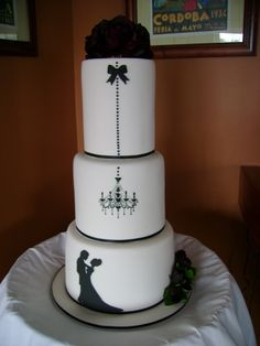 Simple chandelier black and white wedding cake