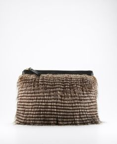 Who knew #AnnTaylor made such great bags?! (Faux chinchilla)