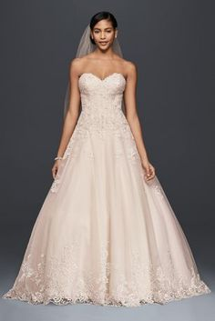 This petite romantic ball gown features beaded lace appliques that begin on the strapless bodice and cascade onto the floaty tulle skirt. A beaded border at the hemline finishes the dress with soft sparkle.  Jewel,exclusively at David's Bridal  Petite  Polyester  Chapel train  Back zipper; fully lined  Dry clean  Imported  Also available in plus size, petite, extra length and plus size extra length