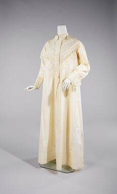 1880 Robe  Culture: American  Medium: cotton  Amelia Beard Hollenback (1844-1918) was the wife of prominent financier and philanthropist John Welles Hollenback (1835-1927). In 1874, the Hollenback family settled in the modestly affluent neighborhood of Clinton Hill in Brooklyn. This nightgown, probably part of her wedding trousseau, features applied bands of embroidery and shirring that convey simultaneously a sense of boldness and delicacy.