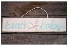 Thinking about a gray, blue, and orange beach themed nursery... this would look great in it! Exactly