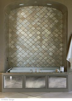 antiqued mirrors on tub skirt to add ligth. Walker Zanger