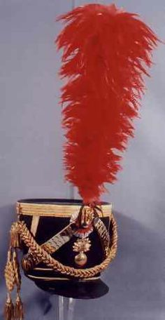 Replica of an 1806 French Army Grenadier Officer's Shako.  The French shako 1806model was the first official model of the shako for Napoleon's army.  It has leather re-enforcing strips at the side in the shape of chevrons.  Originally they were made without chin scales but by 1807 most had them added.