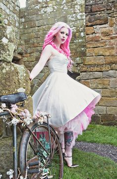 www.lornalovecraft.co.uk Colourful Alternative Bridal Shoot in a Castle! Pink hair and vintage bicycle! <3