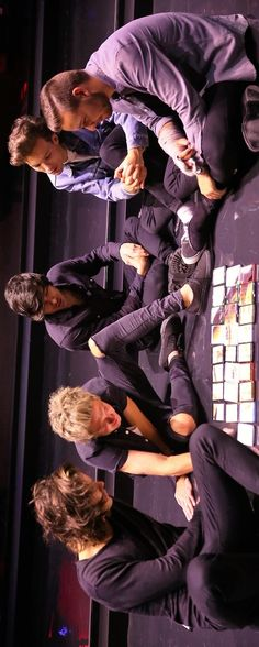 Don't really know what they are doing... but it looks something like a cell phone puzzle & portrait of Niall??