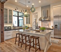 House of Turquoise: Glynis Wood Interiors~White cupboards with wood floor