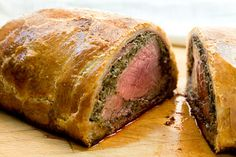 Beef Wellington - A tenderloin roast coated in liver pâté, duxelles (minced mushrooms/onions/herbs) and baked in a puff pastry. I've wanted to try this for so long now; I'm going to make it for my birthday.