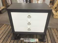 Tribeca Collection nightstand, 339-233, finished in Carbon with Pearl White drawer fronts.