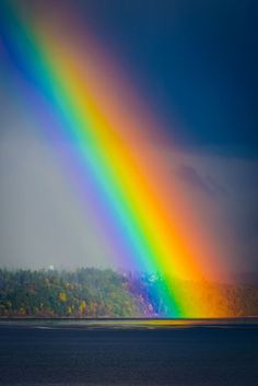 Rainbow ending in Tramp Harbor in the Puget Sound near West Seattle, Washington, USA