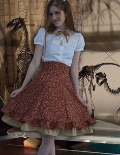 Adorable, handmade, high-waisted skirt... but it's $225. Makes me sad. Oh, and, DINOSAAAUR in the background.
