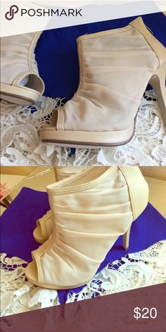 """💖✨Sale💖✨NWT Beige Peep Toe Bootie NWT Beautiful Beige Peep Toe Bootie. Sheer Nude Man Made Material . Approx 3/4"""" stiletto Zip in back. Built in Non Slip Soles. Only Selective Sizes Remaining ❗️❗️ Wild Rose Shoes Heels"""