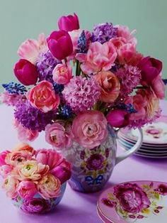 Gorgeous pink and purple centerpiece of ranunculus, daliahs, tulips, cabbage roses...oh yes please.