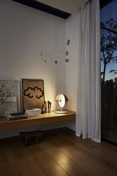 The Theia table lamp by Mathias Hahn has the aim of merging both light and shadow in a single piece. It can be pointed towards you for use as a reading lamp, or towards an object or a wall, creating a subtle, indirect light that immediately warms the atmosphere. Just as in nature itself, these formal elements make it possible for the light from a source to be simultaneously projected, reflected, and absorbed by objects for our visual enjoyment.