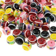 Resin beads  http://www.beads.us/product/Resin-Beads-Round-10mm_p9185.html