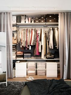 Create a floor-to-ceiling closet by attaching rods and shelves to a wall, then draping off the area with a set of curtains. Define your storage needs, then choose the best spot. Here we moved the bed to the center of the room and built the closet on the wall behind it. — Janice Simonsen, design spokesperson, IKEA