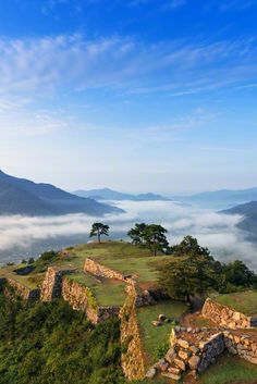 Takeda Castle Ruins, Hyogo, Japan. Takeda Castle was built on this site in the path of aggression between Harima/Tanba and Tajima regions as a stronghold of Izushi Castle. It was built by Ohtagaki Mitsukage, a retainer of Yamana Sozen, lord of the area, in 1441. Ohtagaki, who had been a military commander of the Yamana clan for 5 generations became lord of the castle.