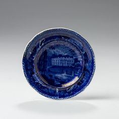 'WHITE HOUSE, WASHINGTON: SHELL BORDER-CIRCULAR CENTER,' EXTREMELY RARE AND UNIQUE STAFFORDSHIRE DARK BLUE TRANSFER-PRINTED CUP PLATE, ENOCH WOOD & SONS, BURSLEM, 1819-46. | Northeast Auctions