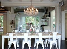 airy, beautiful dining area w/ chandelier, white chairs// via Live Creating Yourself.