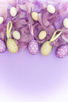 easter decoration with spotted eggs on purple background