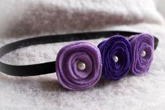 Three shades of purple flower headband with a black elastic on Etsy, $4.00 CAD