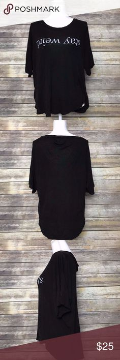 Brandy Melville Stay Weird Sleep Shirt One Size Brandy Melville Women's Long Sleep Shirt Sleepwear Stay Weird - Black - One Size  Excellent pre-owned condition! No flaws. Item has been cleaned and is stored in a smoke free environment.   Approximate Measurements: Bust (Pit to pit): 22.5 inches  Length of garment: 25.5 inches  A43 Brandy Melville Tops Tees - Short Sleeve
