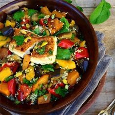 With pan-grilled feta and crushed pistachio dressing.