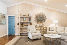 Painting interior doors throughout a house in a rich contrasting color, as  shown here, is an unexpected design move that highlights handsome doors and makes them look like furniture. Learn more about what interior designers know that we don't..