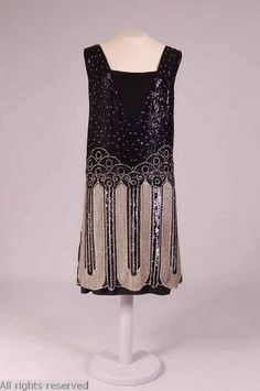 1920s evening dress: the sequences, short sleeves, and short hemline was a common look for young women during the evening hours