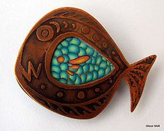 Polymer clay and etched copper.