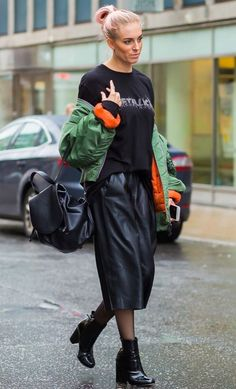 Head to toe black topped with a green and orange bomber jacket. See more street style from Stockholm Fashion Week. Photographed by Photographed by Acielle / Style du Monde.