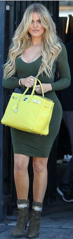 Who made  Khloe Kardashian's green long sleeve dress and yellow tote handbag?