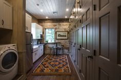 It's all about function. This tack room has custom cabinets and lockers for riders.