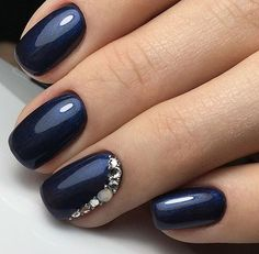 Navy Blue with a glimmer of shimmer and rhinestone encrusted accent nail idea - LadyStyle