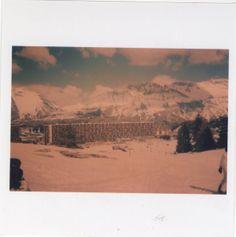snake skin . jacket . ski holiday France. mountain views, snow, sun, panorama, analogue photography