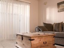 Cozy room with vertical blinds Royalty Free Stock Images