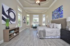 When staging a home to position it well for sale, making sure that you have the appropriate artwork on your walls is critical. You might already know that color appeals to certain psychological triggers for emotion – blues are typically calming colors,