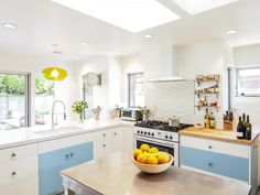 Remodelista-Reader-Rehab-Davis-Bungalow-pendant-light-skylights-custom-counters  Fun to have some color, plus openness of this kitchen