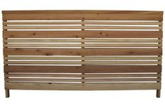 A good solution for a short fence (like picket fencing) with a contemporary look, the Three-foot Redwood Flat Top Fence Panel; $50.32 per six-foot section at Lowe's.