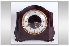 Lot 1118 - Smiths Art Deco Brown Bakelite Striking Mantel Clock. 7.5 Inches High, 8.5 Inches Wide. Working