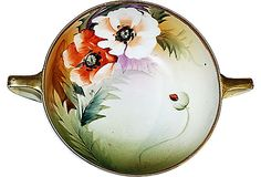 A lovely Nippon hand-painted soup-consommé bowl in lovely floral colors with gold trim.