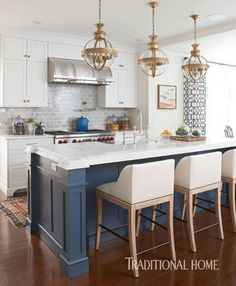 Gray-blue subway tile with a variegated crackle finish complements the navy island and gray veining in quartzite countertops. - Photo: Michael Partenio / Design: Katie Rosenfeld