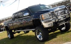 From CarBuyingTips.com What an Awesome 2008 #Chevrolet #Silverado 2500 HD custom truck. We saw this at #BarrettJackson last weekend.  Looks like it should fit in a normal parking space!  Yeah right... Sold for $40,700.00  #chevy #silverado #chevysilverado #chevytruckmonth #truck #pickuptruck Silverado 2500, Chevrolet Silverado, Barrett Jackson Auction, Parking Space, Custom Trucks, Pickup Trucks, Palm Beach, Cool Cars, Type