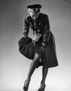 Model wearing black stockings, fitted dress coat, fur trimmed hat and fur muff, adjusting garter, Photo Gjon Mili Vintage Stockings, Silk Stockings, Black Stockings, Moda Vintage, Vintage Mode, Vintage Ladies, Lingerie Vintage, Vintage Glamour, 1940s Fashion